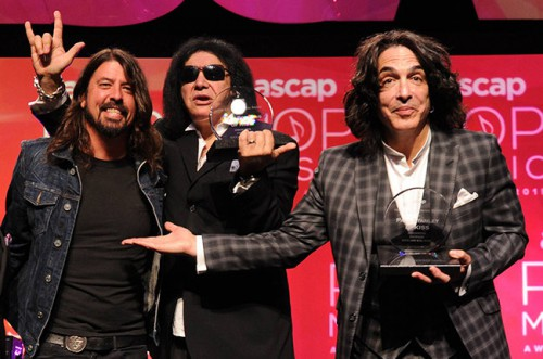 HOLLYWOOD - APRIL 29: From left, ASCAP EVP Creative Services John Titta and Dave Grohl present Gene Simmons and Paul Stanley with the ASCAP Founders Award at the 32nd Annual ASCAP Pop Music Awards at the Loews Hollywood Hotel on April 29, 2015 in Hollywood, California. (Photo by Frank Micelotta/PictureGroup)